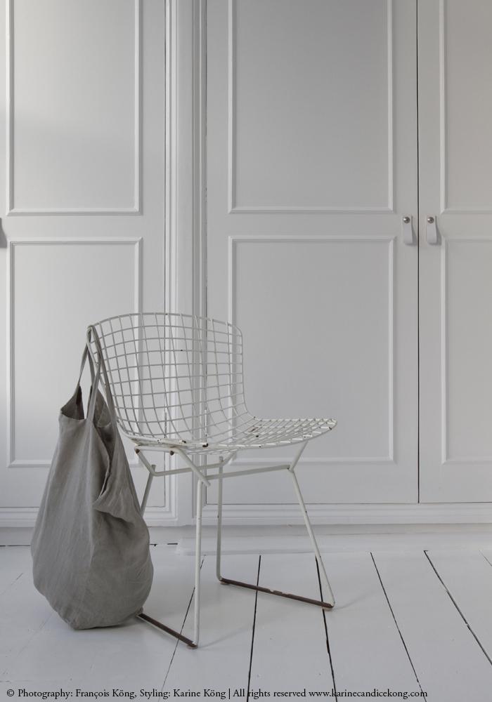 white cupboards, Bertoia chair, linen bag. More on www.karinecandicekong.com
